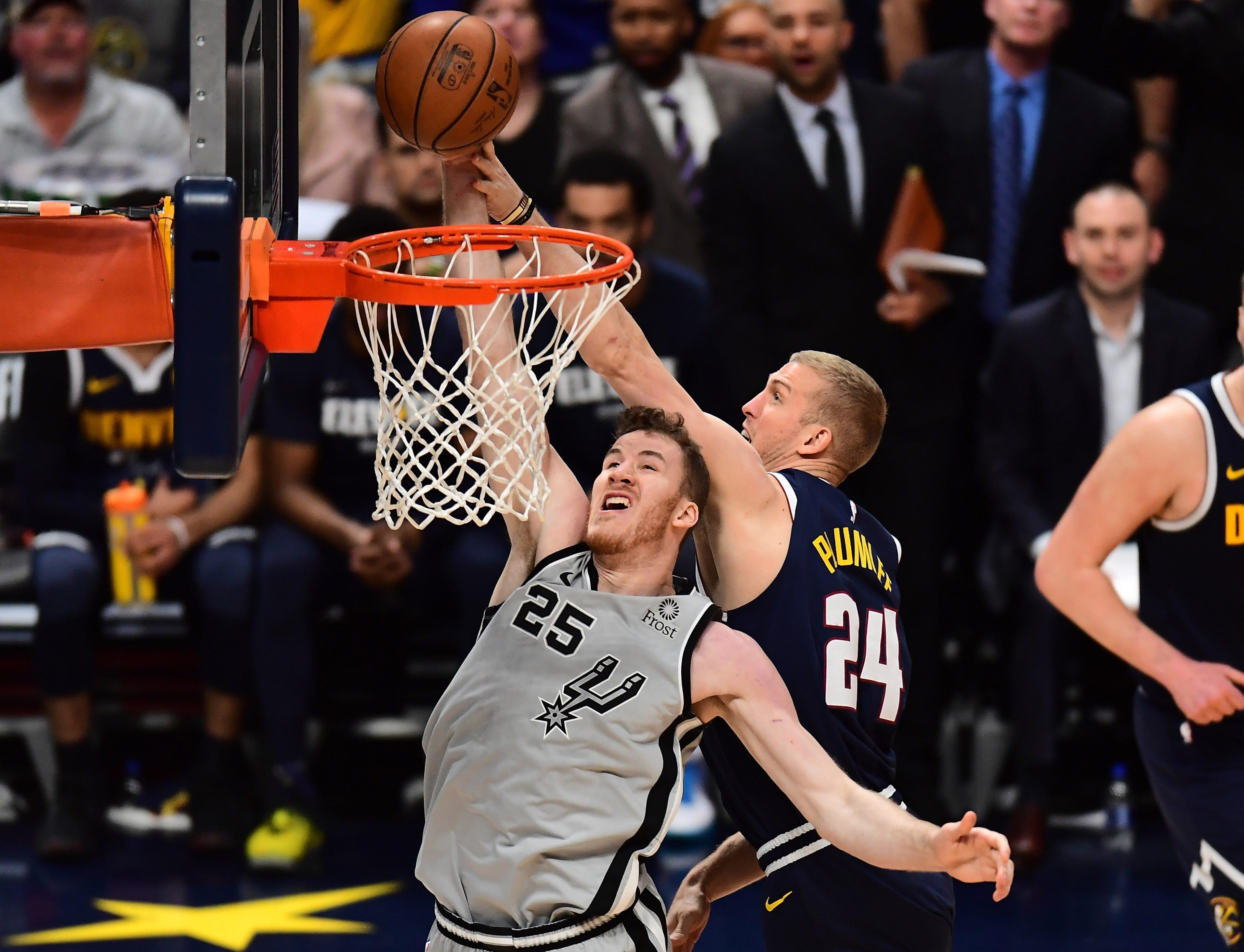 April 27: Nuggets defender Mason Plumlee (24) blocks a shot attempt by Spurs center Jakob Poeltl (25) during Game 7.