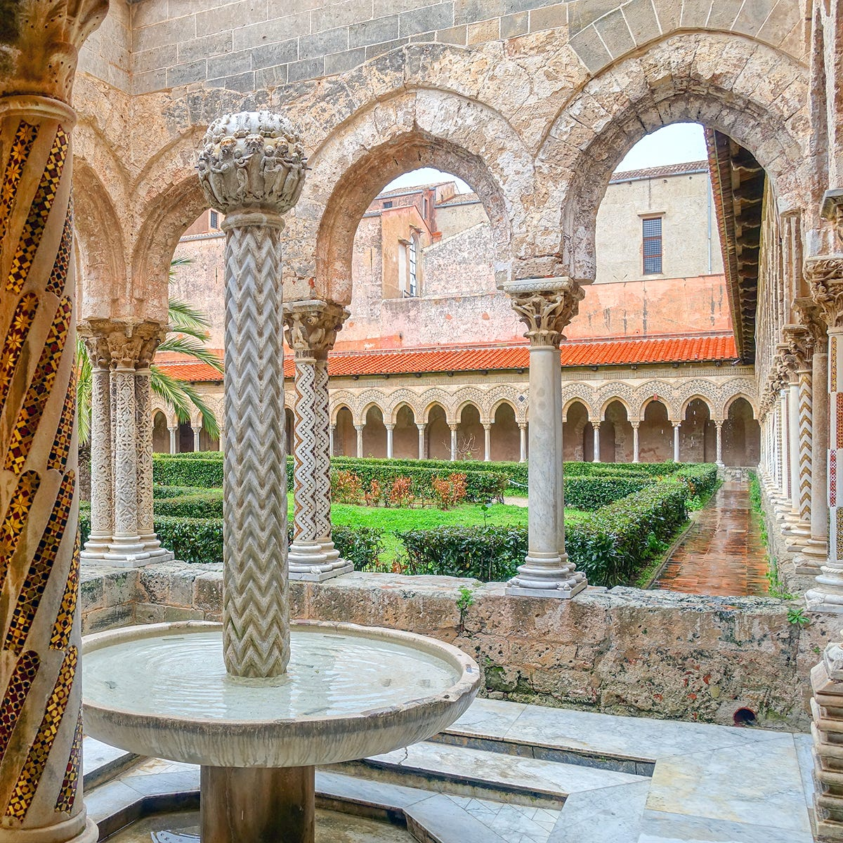 Surrounding Monreale Cathedral's cloister, 228 twin columns feature intricately carved capitals and Moorish-influenced mosaics.