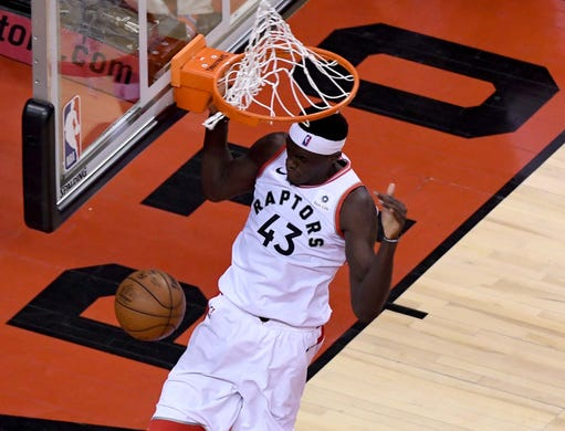 April 27: Raptors forward Pascal Siakam throws down the two-handed slam during Game 1 against the 76ers in Toronto.