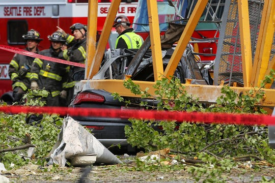A construction crane working on a building collapsed near the intersection of Mercer Street and Fairview Avenue near Interstate 5, Saturday, April 27, 2019, in downtown Seattle.