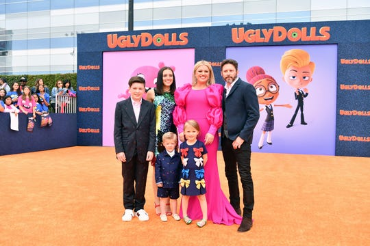 "Kelly Clarkson, center, brought her family of six to the Los Angeles premiere of ""UglyDolls"" on Saturday. From left: Her stepchildren Seth Blackstock and Savannah Blackstock, son Remington Blackstock, daughter River Rose Blackstock, and husband Brandon Blackstock, far right."