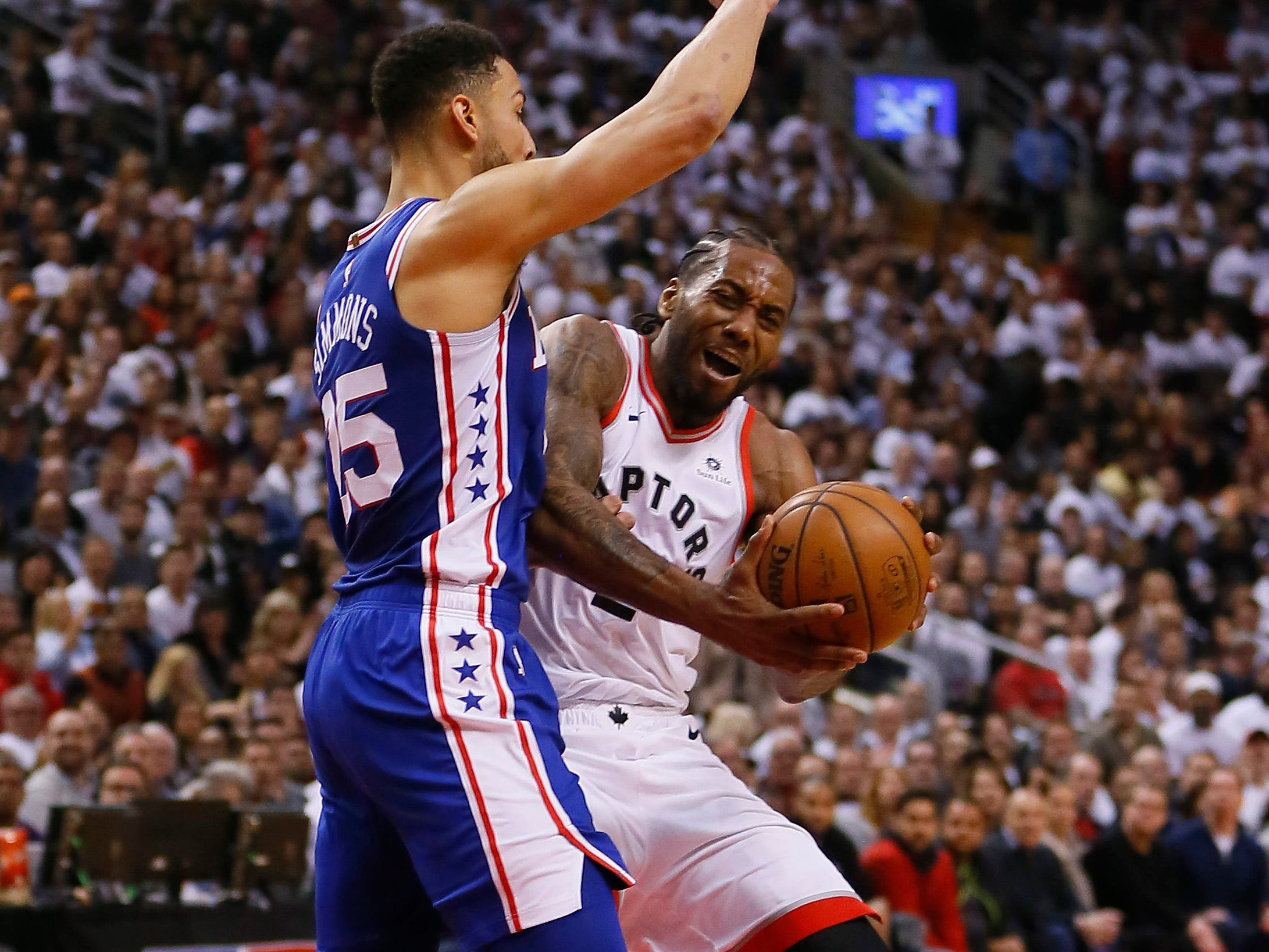 April 27: Raptors forward Kawhi Leonard (2) takes the bump as he drives to drive against 76ers defender Ben Simmons (25) during Game 1.