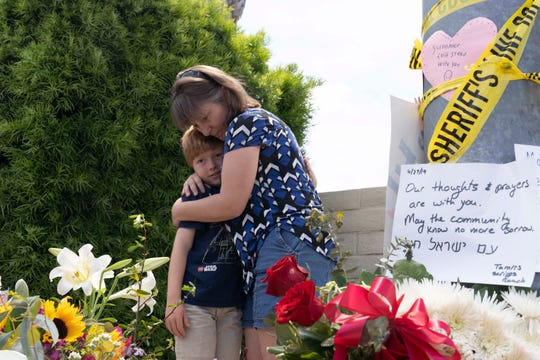 Heather Fay with her son Marshall came to add flowers and notes at the memorial site across from the Chabad of Poway synagogue on April 28, 2019.