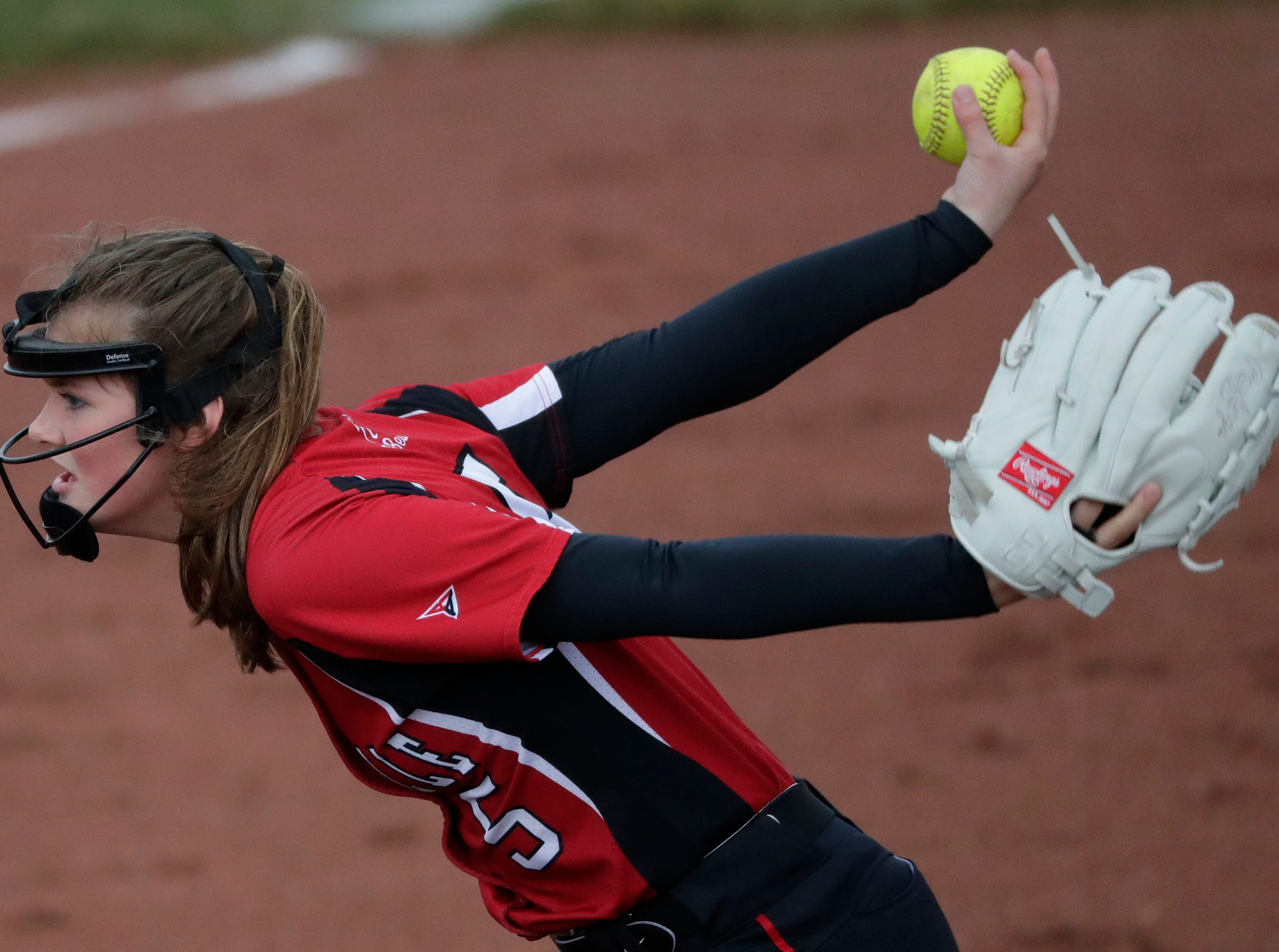 Hortonville High School's Hannah Meshnick (5) pitches against Appleton North High School during their girls softball game Monday, April 22, 2019, in Appleton, Wis. 