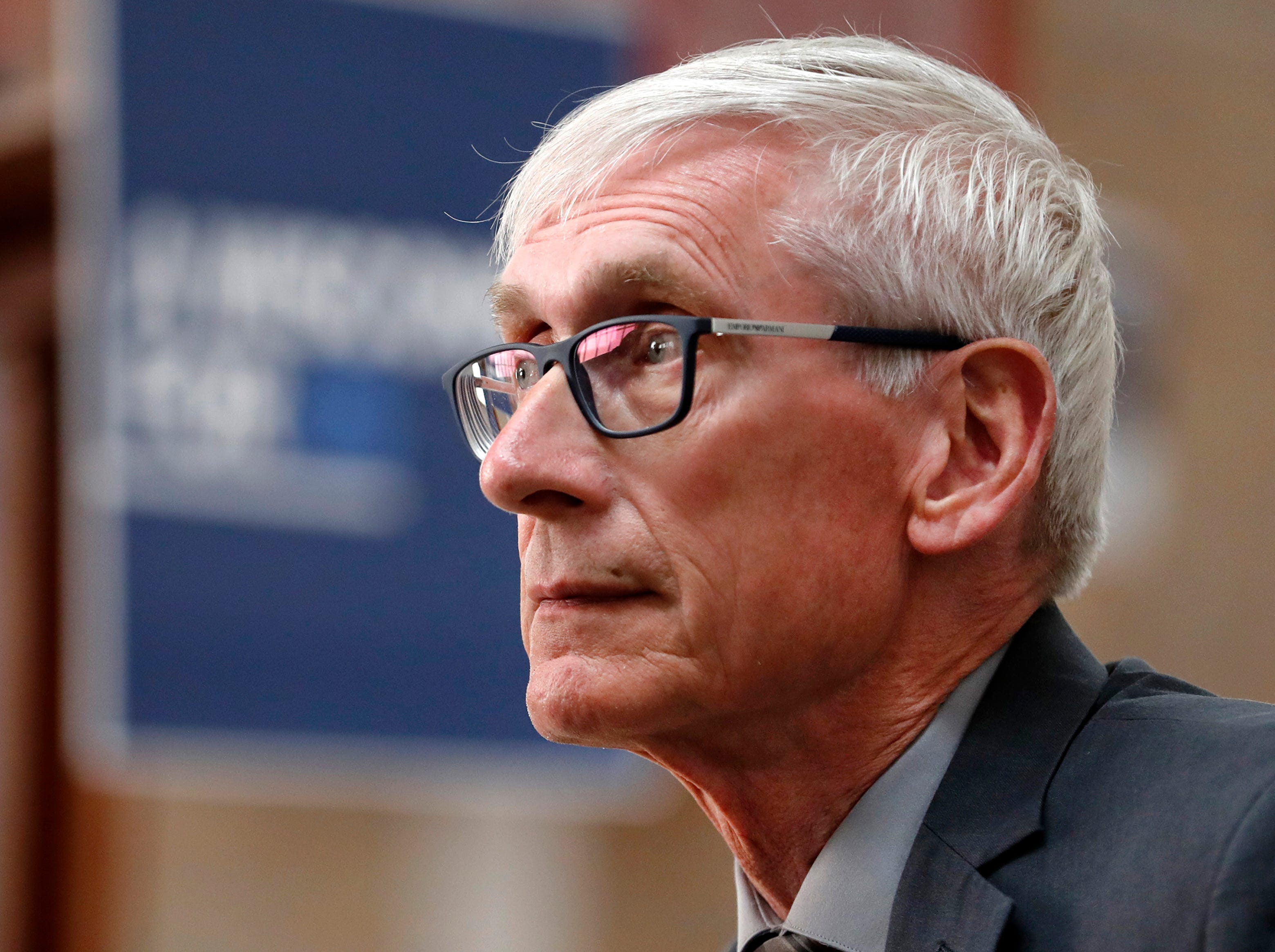 Gov. Tony Evers sits in on a group discussion about transportation during his stop at the Oshkosh Senior Center for The People's Budget Listening Session Tour Tuesday, April 23, 2019, in Oshkosh, Wis. 