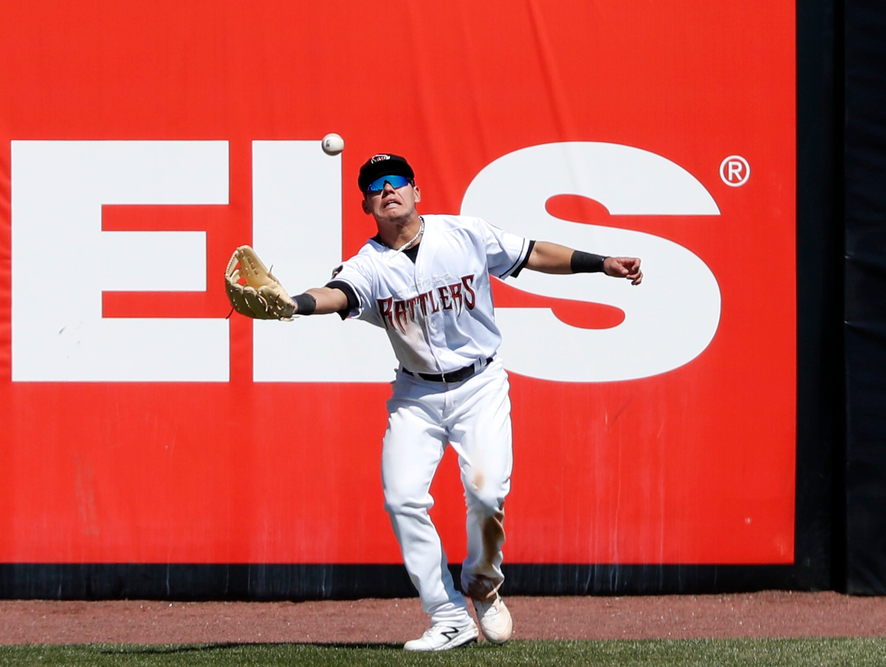 The Timber Rattlers' Jesus Lujano makes a catch against the Cedar Rapids Kernels Tuesday, April 23, 2019, at Neuroscience Group Field at Fox Cites Stadium in Grand Chute, Wis. 