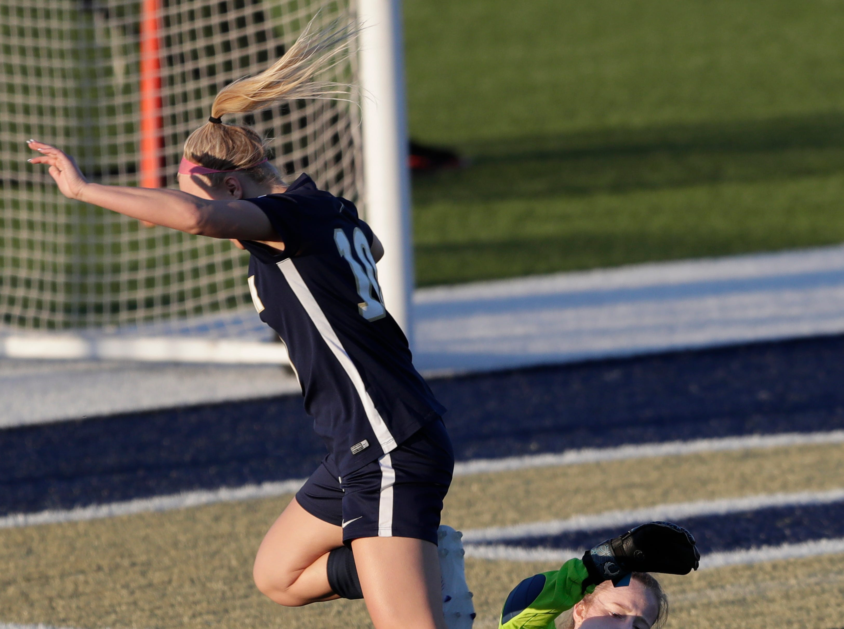 Kaukauna High School's keeper Autumn Steffens (25) stops Appleton North High School's Abby Kloiber (10) from scoring a goal during their girls soccer game Tuesday, April 23, 2019, in Appleton, Wis. 