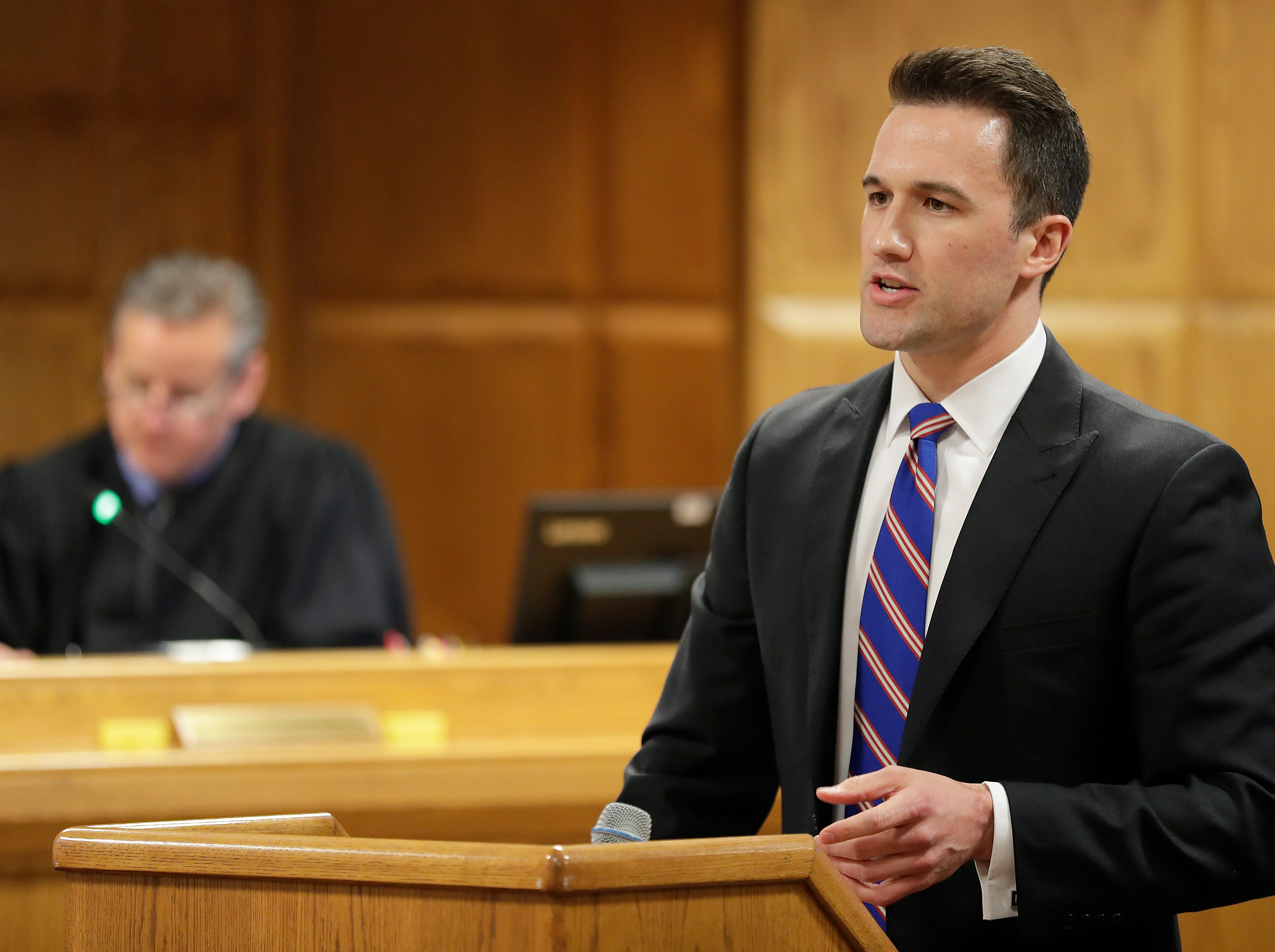 Assistant District Attorney Patrick Leigl makes an opening statement  during day 1 of of a jury trial of Jason Lavigne in Outagamie County Court on Tuesday, April 23, 2019, in Appleton, Wis. Lavigne is a former Little Chute High School teacher accused of sexually assaulting a 14-year-old student in 1999
