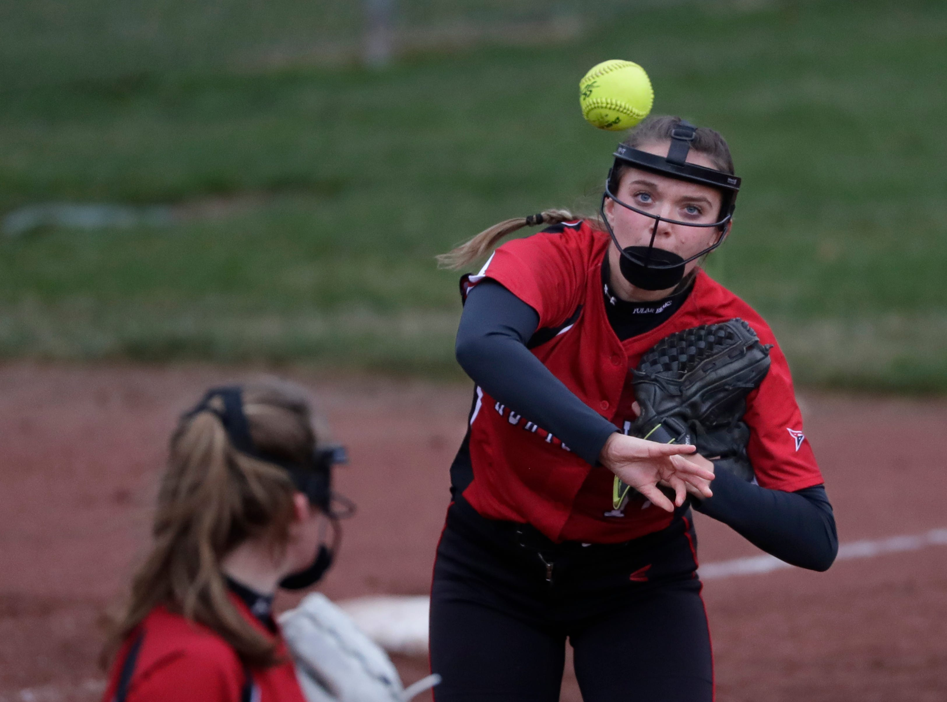 Hortonville High School's Hailey Wenzel (12) throws to first base against Appleton North High School during their girls softball game Monday, April 22, 2019, in Appleton, Wis. 