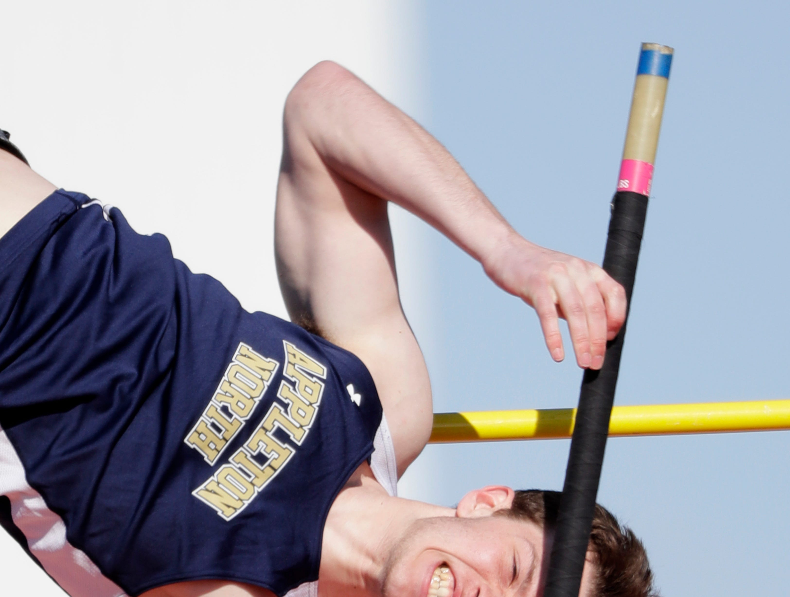 Appleton North High School's Tayte Cvancara competes in the pole vault event during the Neenah co-ed invitational track and field meet Friday, April 26, 2019, at Neenah High School in Neenah, Wis. 