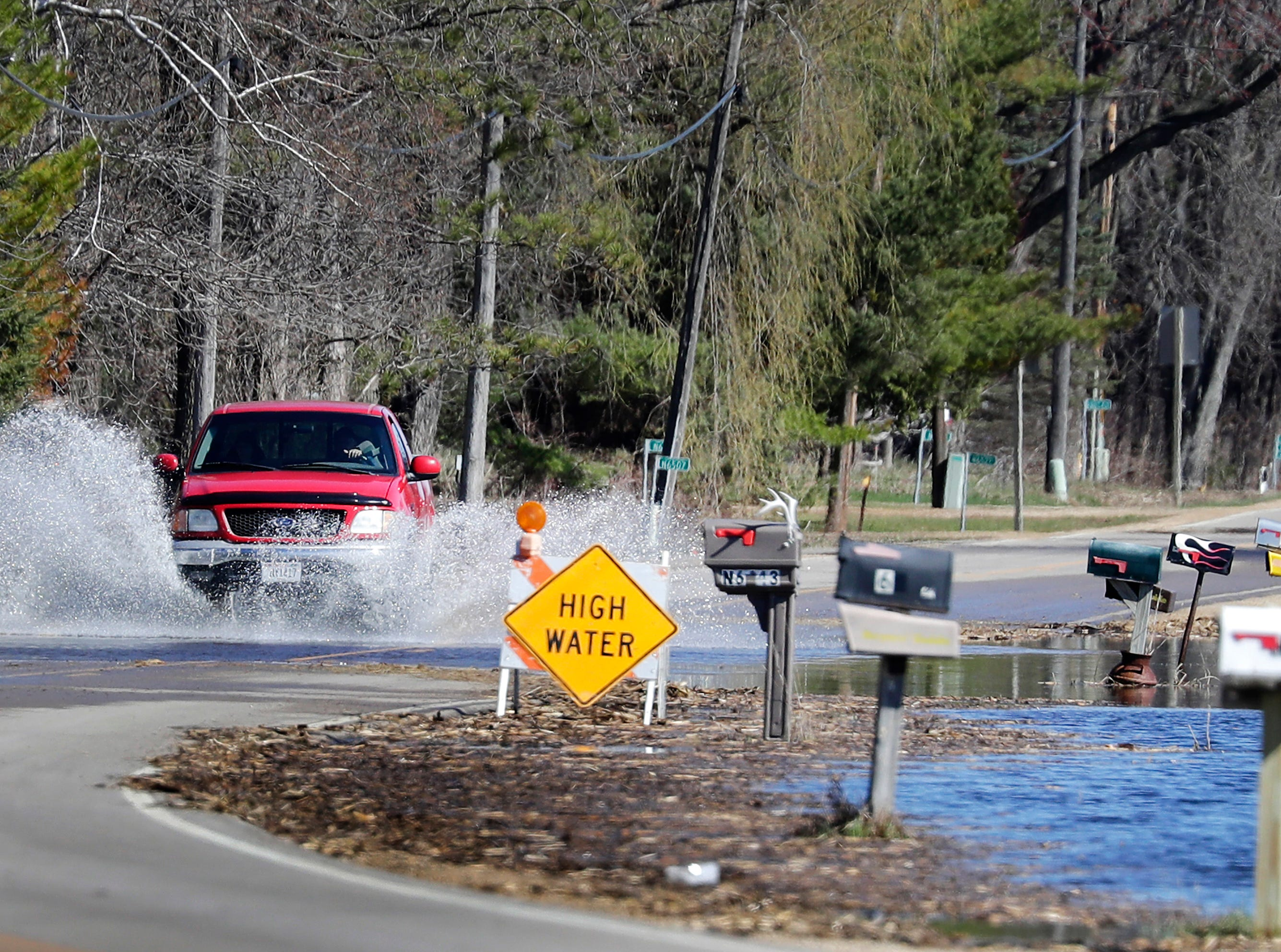 High water covers Hwy 187 during flooding along the Wolf River on Tuesday, April 23, 2019, in Shiocton, Wis. 