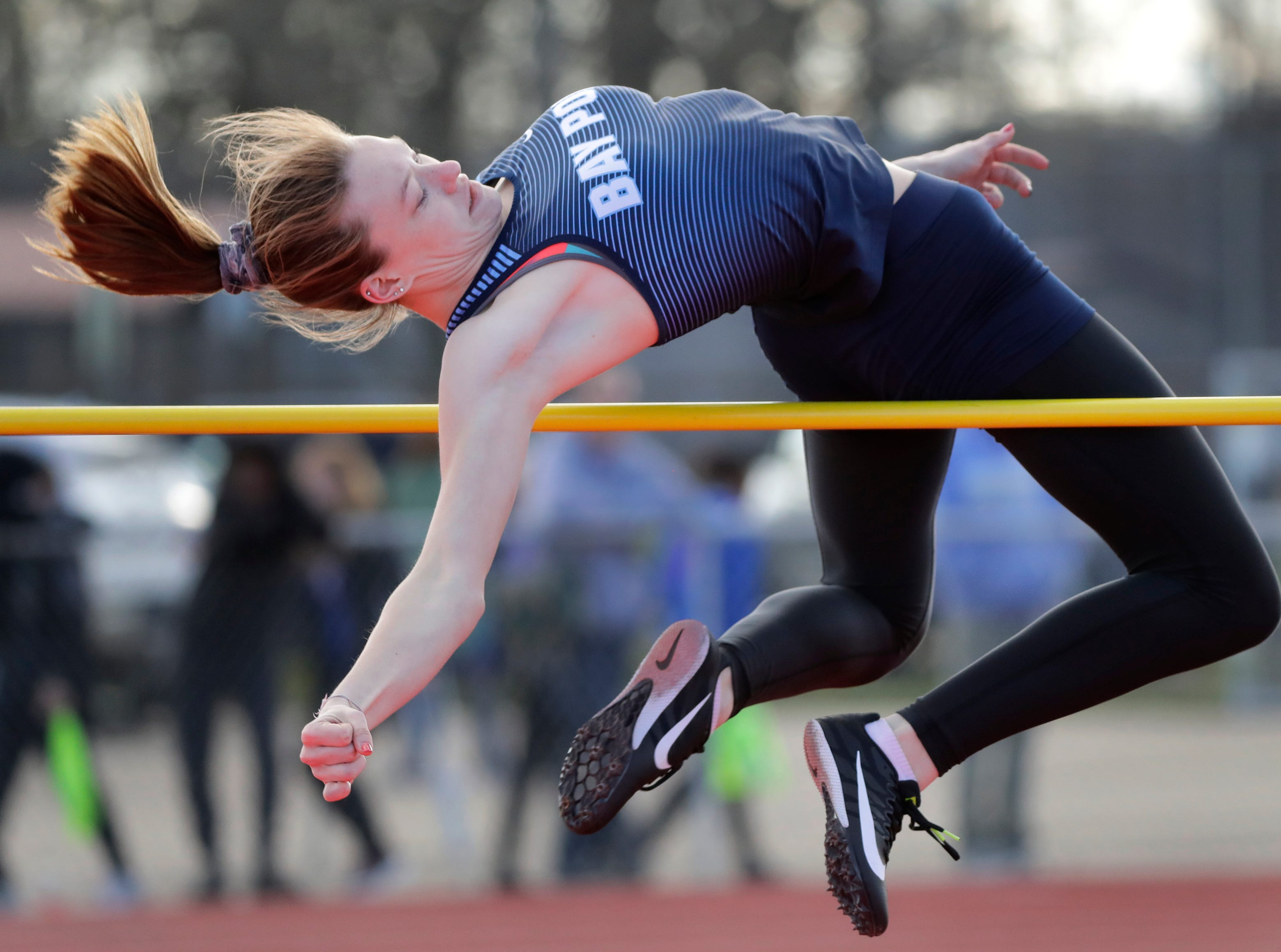 Bay Port High School's Sydney Palomaki competes in the high jump event during the Neenah co-ed invitational track and field meet Friday, April 26, 2019, at Neenah High School in Neenah, Wis. 