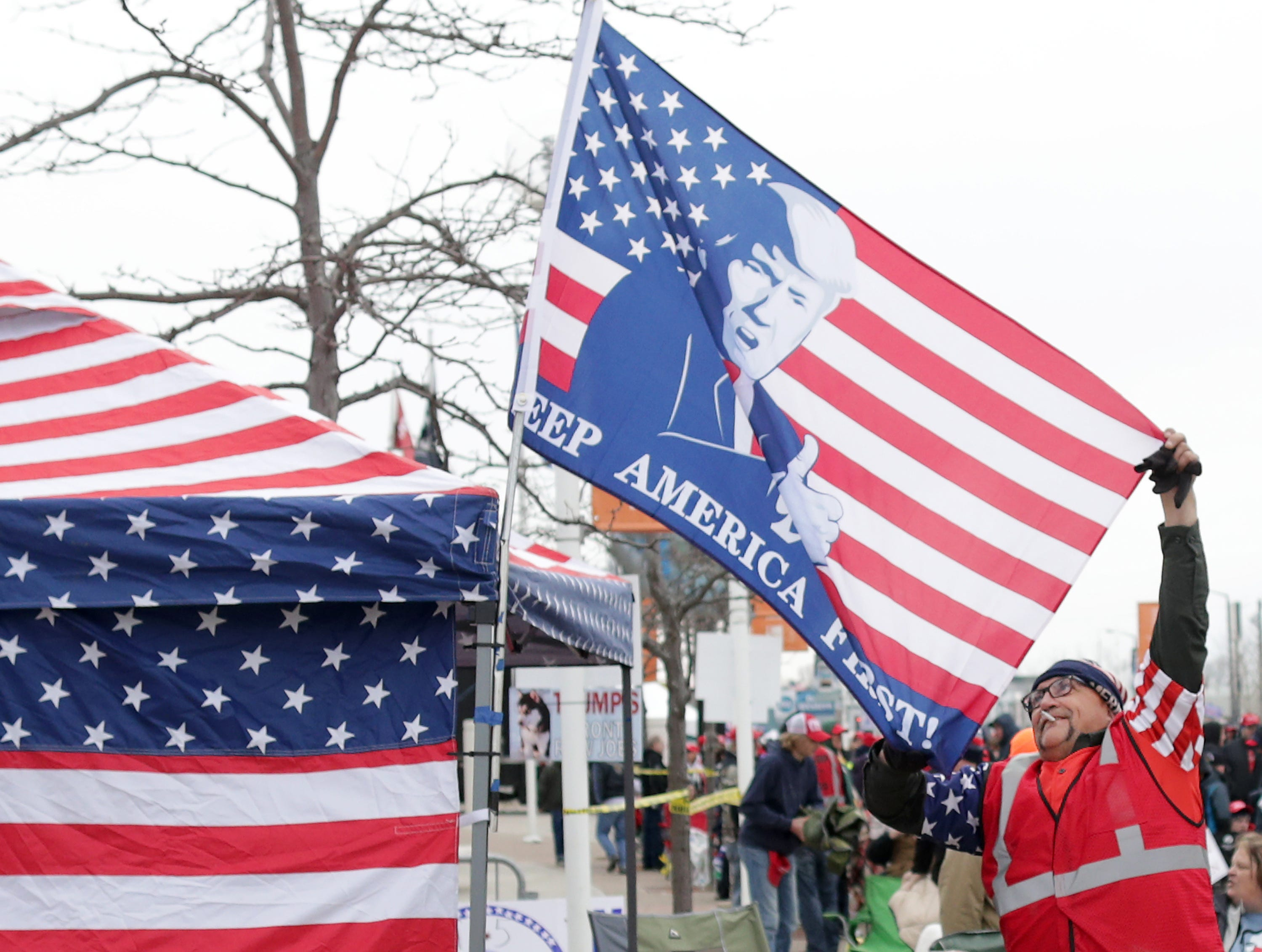 Randal Thom, Lakefield Minn., adjusts a flag while waiting in line before President Donald J. Trump's Make America Great Again Rally on Saturday, April 27, 2019, at the Resch Center in Green Bay, Wis. Randal is with a group called Trump's Front Row Joe's that waited in line overnight.