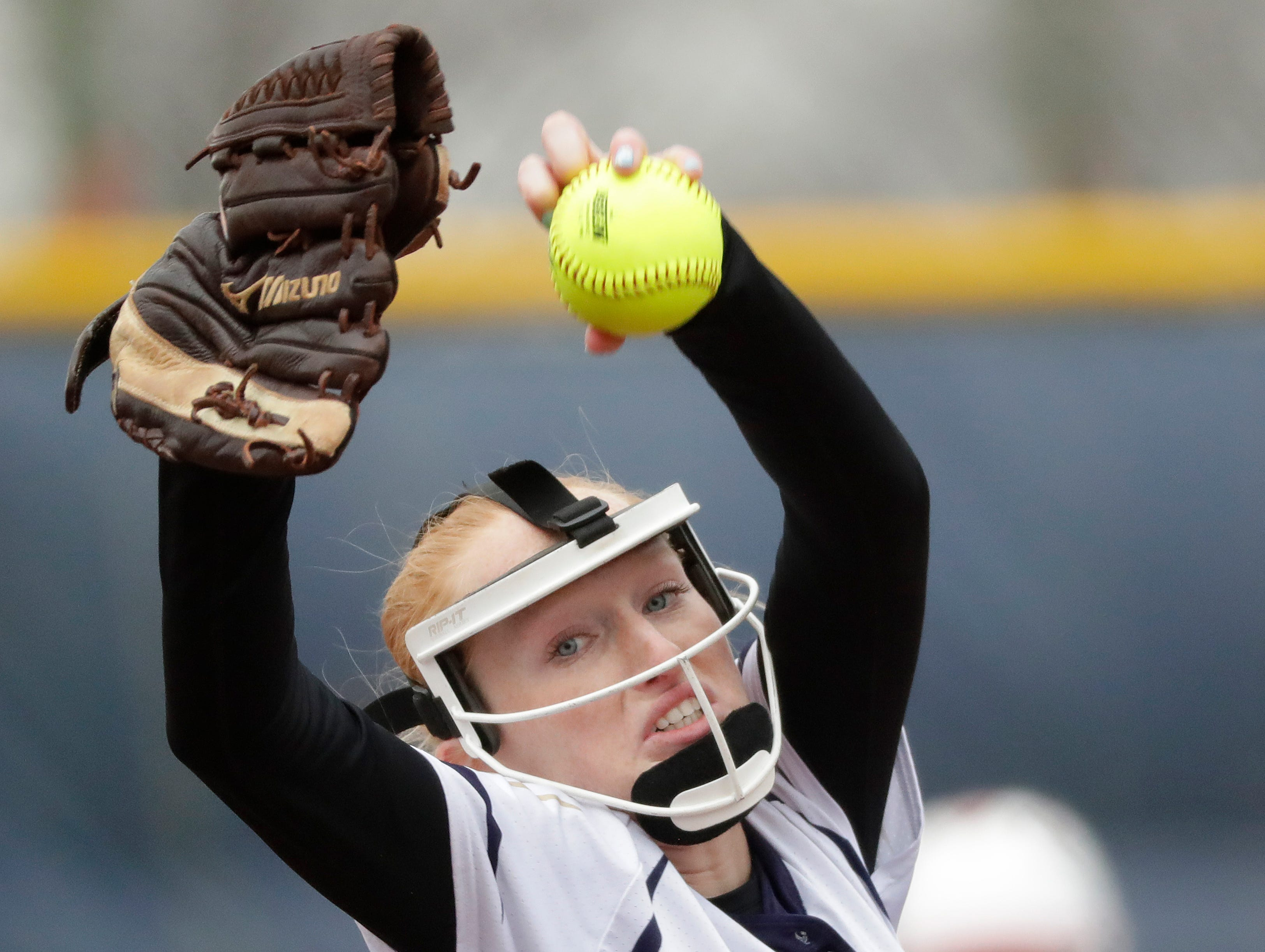 Appleton North High School's Bailee Fritz (5) pitches against Hortonville High School during their girls softball game Monday, April 22, 2019, in Appleton, Wis. 