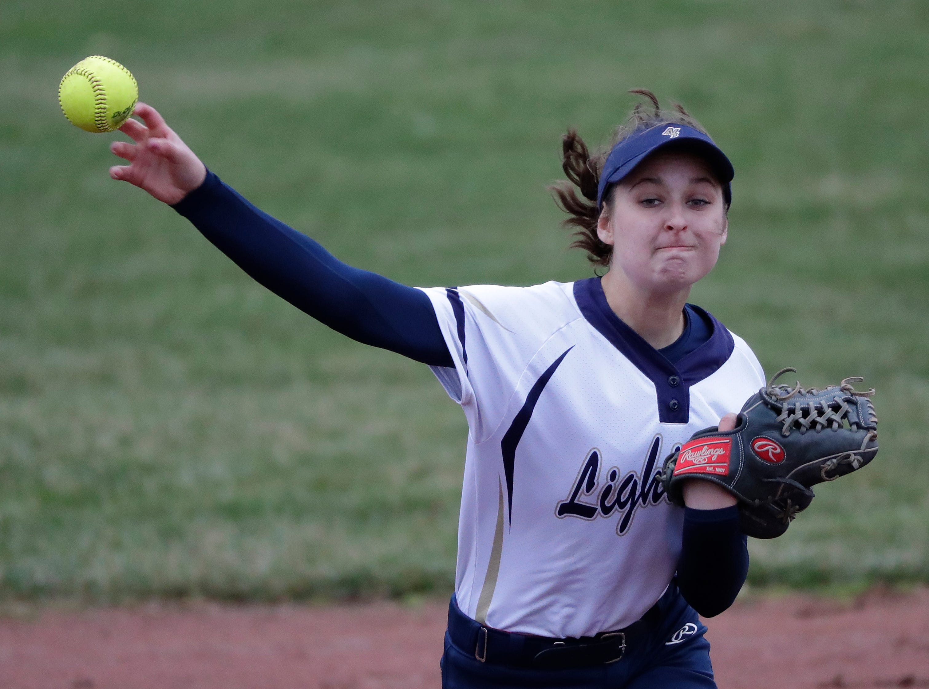 Appleton North High School's Lydia Krueger (11) throws to first base against Hortonville High School during their girls softball game Monday, April 22, 2019, in Appleton, Wis. 