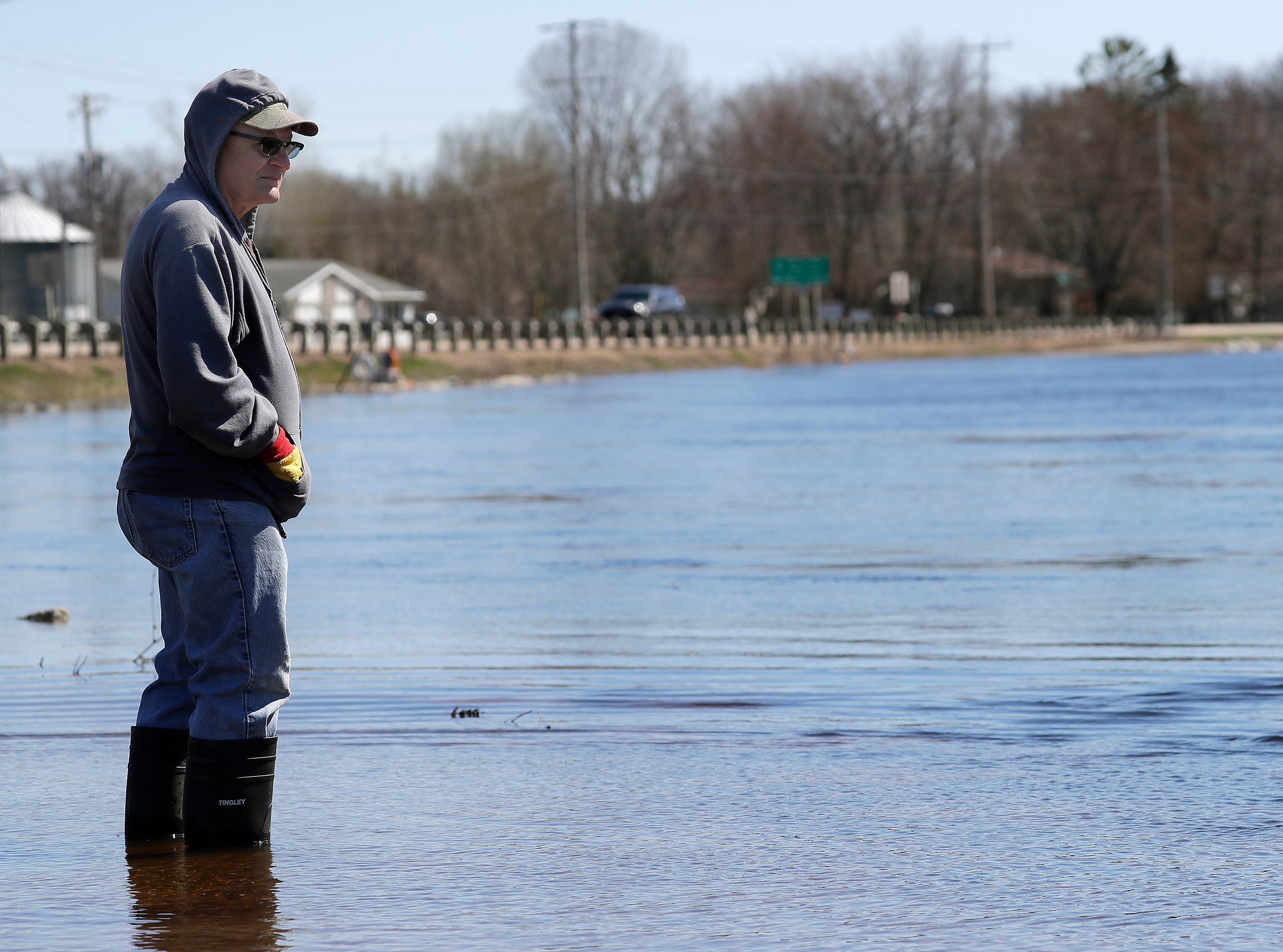 Dan Guyette, Mackville, watches the spring sturgeon spawn from a flooded trail at Bamboo Bebd during flooding along the Wolf River on Tuesday, April 23, 2019, in Shiocton, Wis. 
