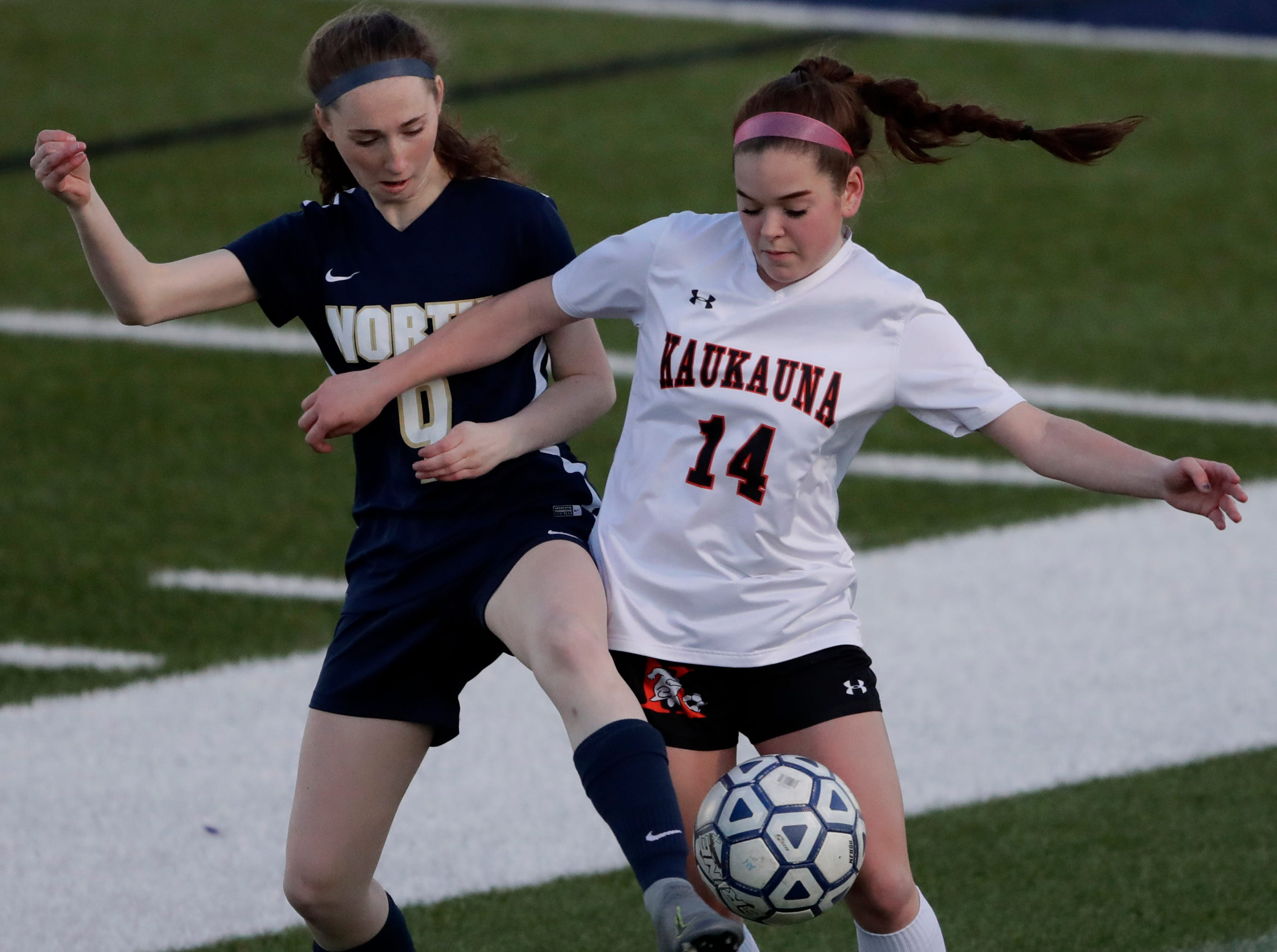 Appleton North High School's Carsen Desens (9) defends against Kaukauna High School's Hanna Brouch (14) during their girls soccer game Tuesday, April 23, 2019, in Appleton, Wis. 
