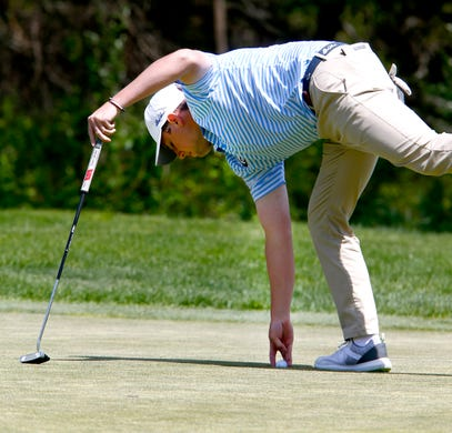 CBA's Jack Wall picks up his ball after putting on the 14th hole during the Boys Shore Conference Tournament at Charleston Springs Golf Course in Millstone Monday, April 29, 2019.