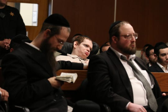 Eliezer Eisemann attends the sentencing of his father, Rabbi Osher Eisemann, the founder of Lakewood special education school the School for Children with Hidden Intelligence who was found guilty of two criminal counts after a trial and faces prison time for the crimes, before Judge Benjamin S. Bucca, Jr. at the Middlesex County Courthouse in New Brunswick,NJ Monday, April 29, 2019.