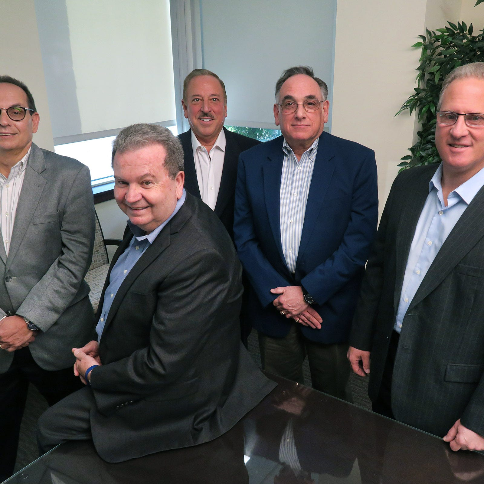 Cg accounting firm grows by being much more than number crunchers