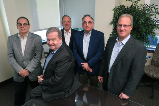 """Some of the leadership team of """"Cg Tax, Audit & Advisory,"""" a 38-year-old tax, audit, and advisory firm, gather for a photo in their Tinton Falls board room Monday, April 29, 2019.  They are (l-r):  Joe Gunteski, Don Cowan, Stephen Reed, Mike Lewis and Michael DeMola."""