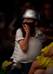 """Aiden Wright, 10, watches the cosplay contest dressed as Crazy Dave from the """"Plants vs. Zombies"""" video game Saturday."""