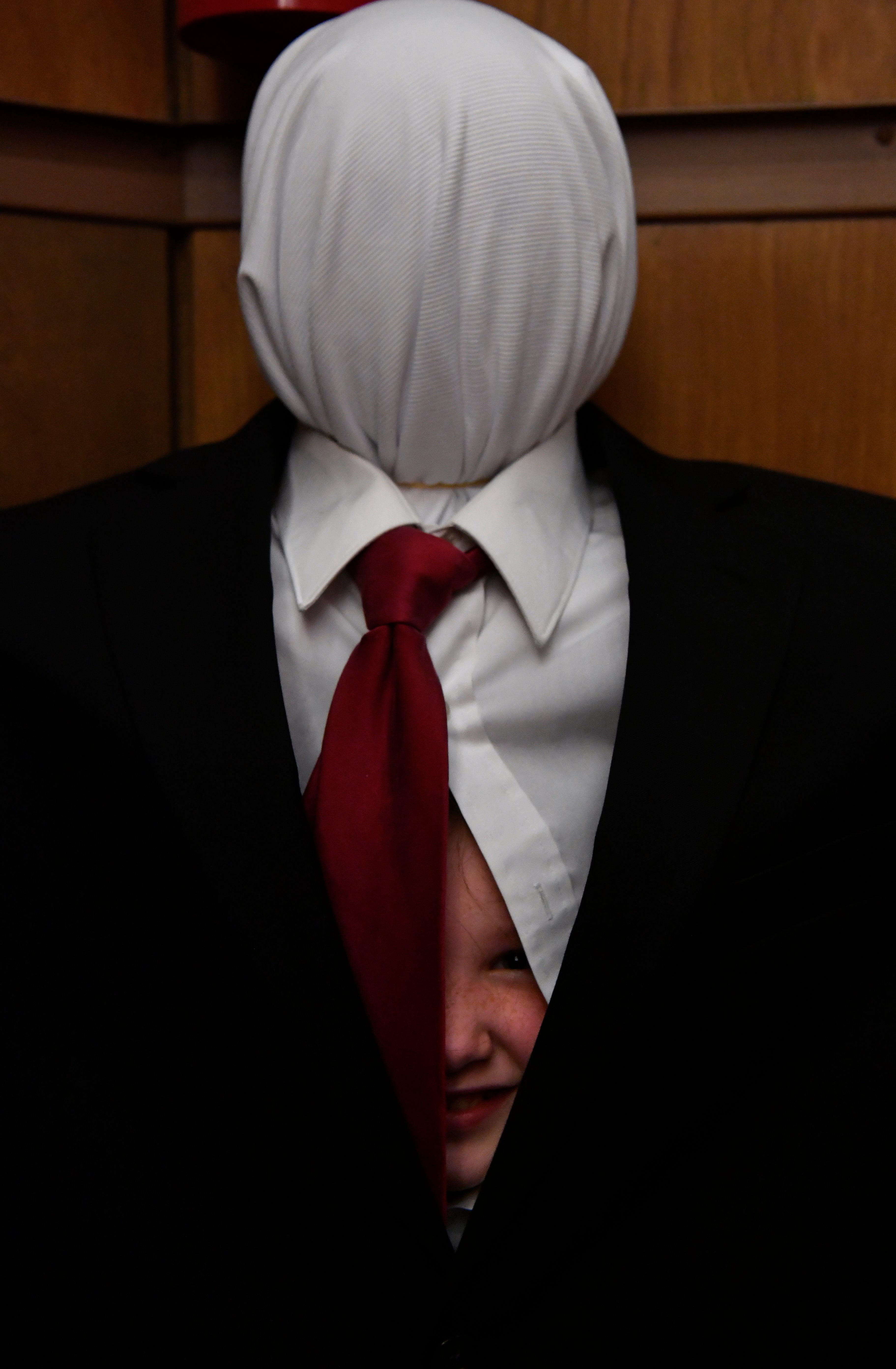 Jocelyn Alldredge, 8, peeks out from insider her costume as Slenderman during Saturday's Libcon cosplay contest. The costume contest featured a wide range of styles and genres.