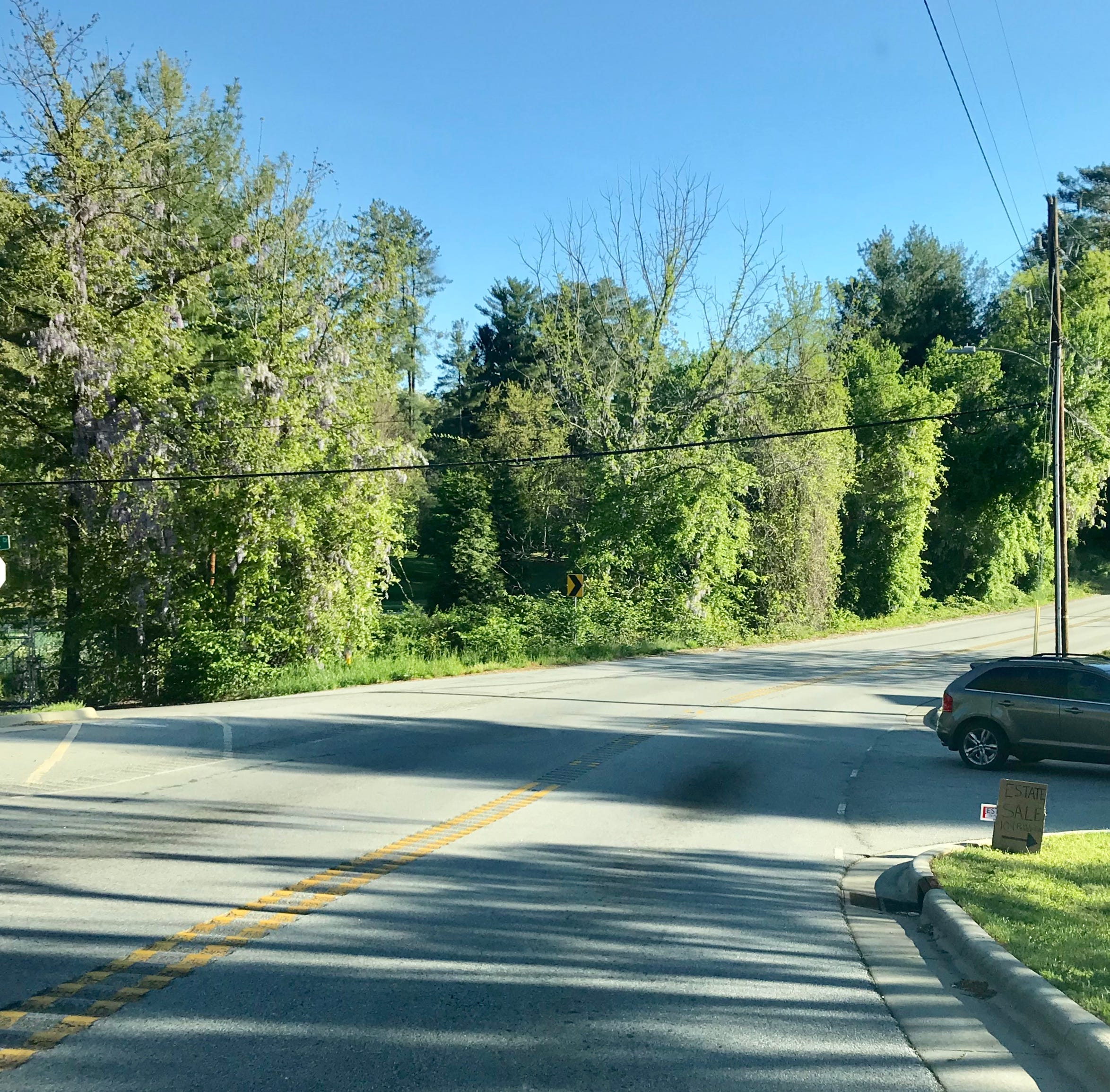 Answer Man: Overlook Road widening on tap? Flashers in a downpour?
