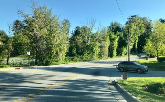 Overlook Road, a popular cut-through between Hendersonville Road and Long Shoals Road, is slated for improvements near Hendersonville Road later this summer. This section, featuring a sharp curve, was improved in 2012.