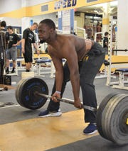 Battle Creek Central's Jaquan West competes in the deadlift during the All-City LIft-A-Thon on Sunday.