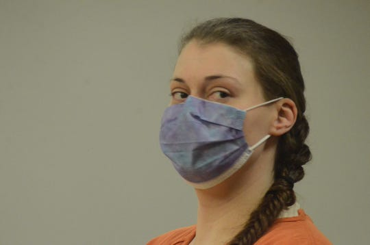 Talia Furman appears in court wearing a disposable mask for her sentencing.