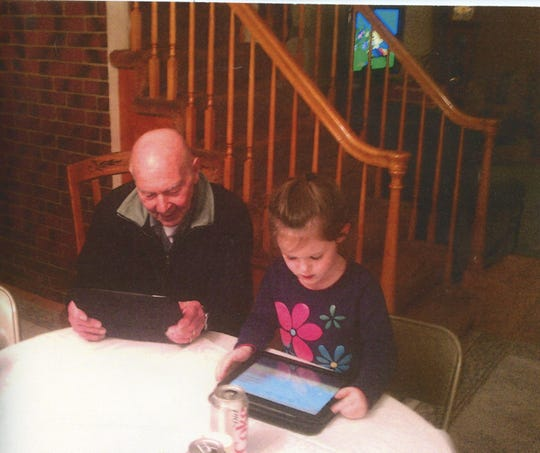 Joe Puhusky, shown playing a video game with his great-granddaughter, Molly, was young at heart, his family said.