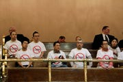 Opponents of an initiative to the Legislature that would allow the state to use hiring and recruitment goals, but not quotas, to bring minority candidates into state jobs, education, and contracting sit in the public gallery in the Washington House, on Sunday, April 28, 2019, in Olympia, Wash. The measure loosens restrictions enacted in a separate 1998 initiative that banned government discrimination or preferential treatment based on factors like race or gender.