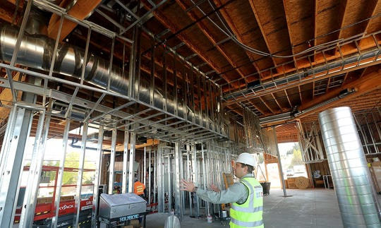 """Maynard's owner and executive chef JJ Meland gives a tour of the building under construction on Bucklin Hill in Silverdale on Monday. Dubbed """"Kitsap's Culinary Destination"""" the enterprise will be a restaurant, market and distillery."""