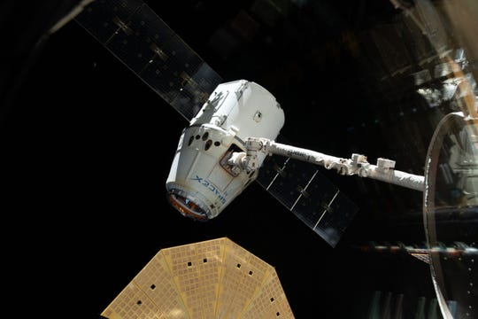 An uncrewed, robotic SpaceX Dragon capsule is seen at the International Space Station on Jan. 13, 2019.
