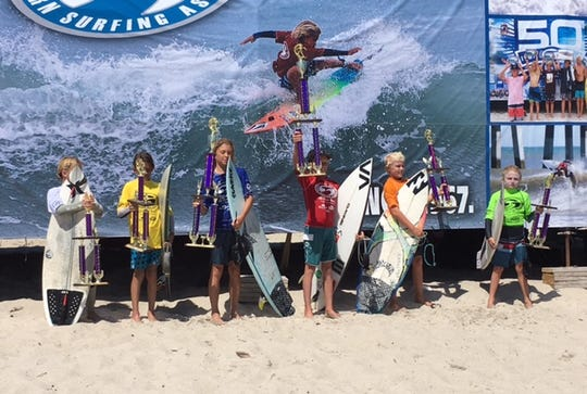 The finalists in the boys 12-under division at the ESA Southeast Regionals show off their awards.