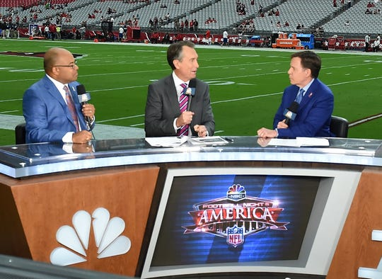 Sunday Night Football commentators Mike Tirico, Cris Collinsworth and Bob Costas report prior to the NFL game between the New England Patriots and Arizona Cardinals at University of Phoenix Stadium on September 11, 2016 in Glendale, Arizona. Collinsworth attended Astronaut High in Titusville before playing with the Florida Gators and Cincinnati Bengals.
