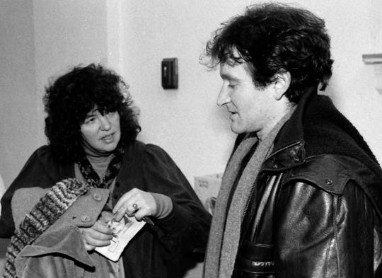 1983: Robin Williams backstage with Free Press Reporter Susan Green during a benefit show in St. Johnsbury.