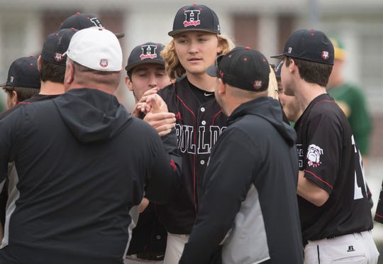 Haddonfield's Dylan Heine, center, celebrates with teammates and coaches after Haddonfield defeated Audubon, 2-0, on Monday, April 29, 2019 at Audubon High School.  Heine threw a complete-game shutout in Haddonfield's victory over Audubon.