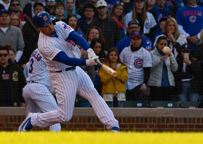 Apr 13, 2019; Chicago, IL, USA; Chicago Cubs right fielder Mark Zagunis (2) hits a two RBI single against the Los Angeles Angels in the eighth inning at Wrigley Field. Mandatory Credit: Matt Marton-USA TODAY Sports