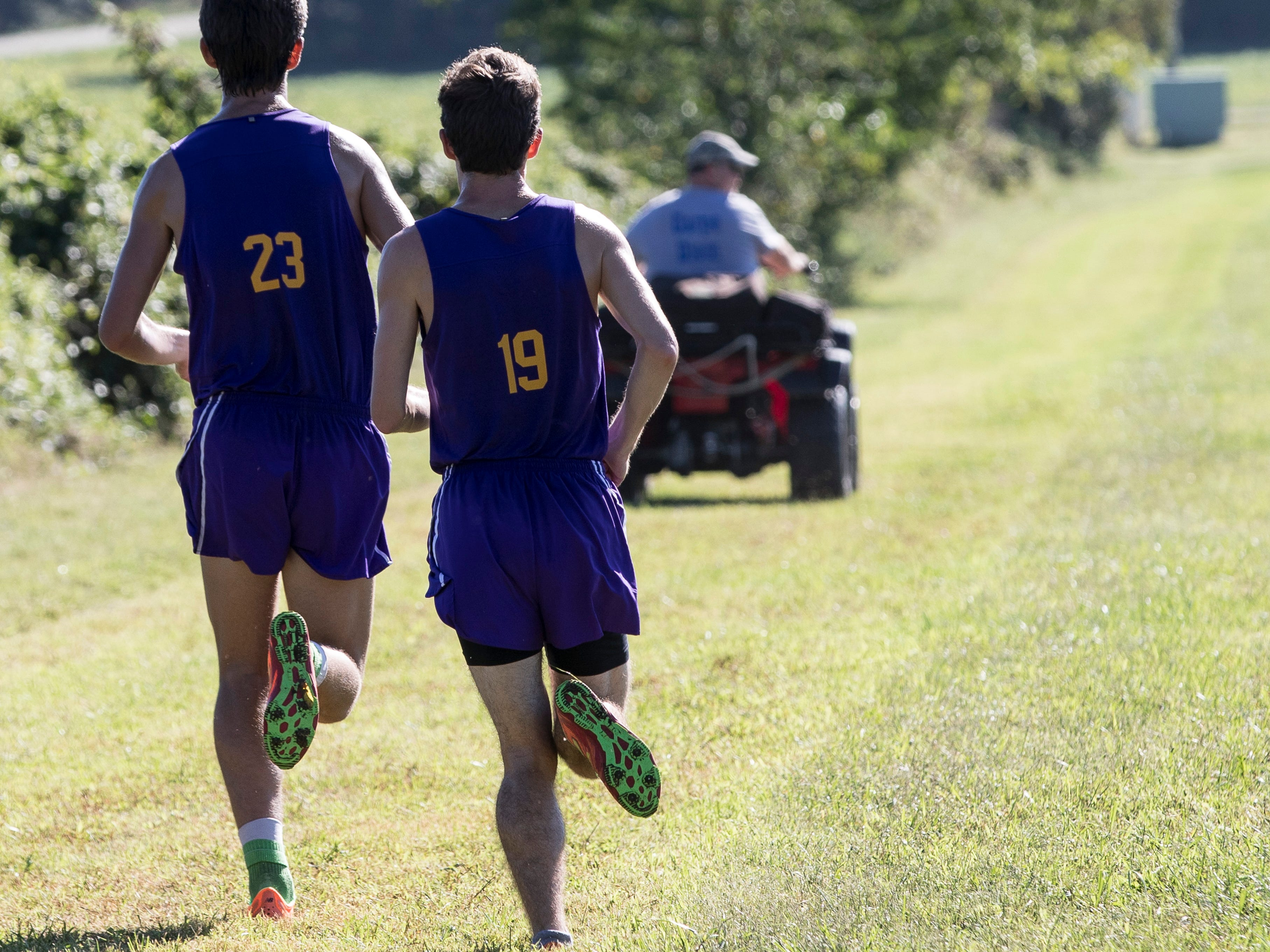 Unioto junior Eric Hacker, right, runs side by side with fellow teammate Tucker Markko at the 2018 Aaron Reed Memorial Invitational cross-country race where he took second place to Markko. While Hacker's bowed leg, a gait disorder left over from his cerebral palsy, is noticeable as he runs, it hasn't stopped him from becoming one of the top long-distance runners in the area.