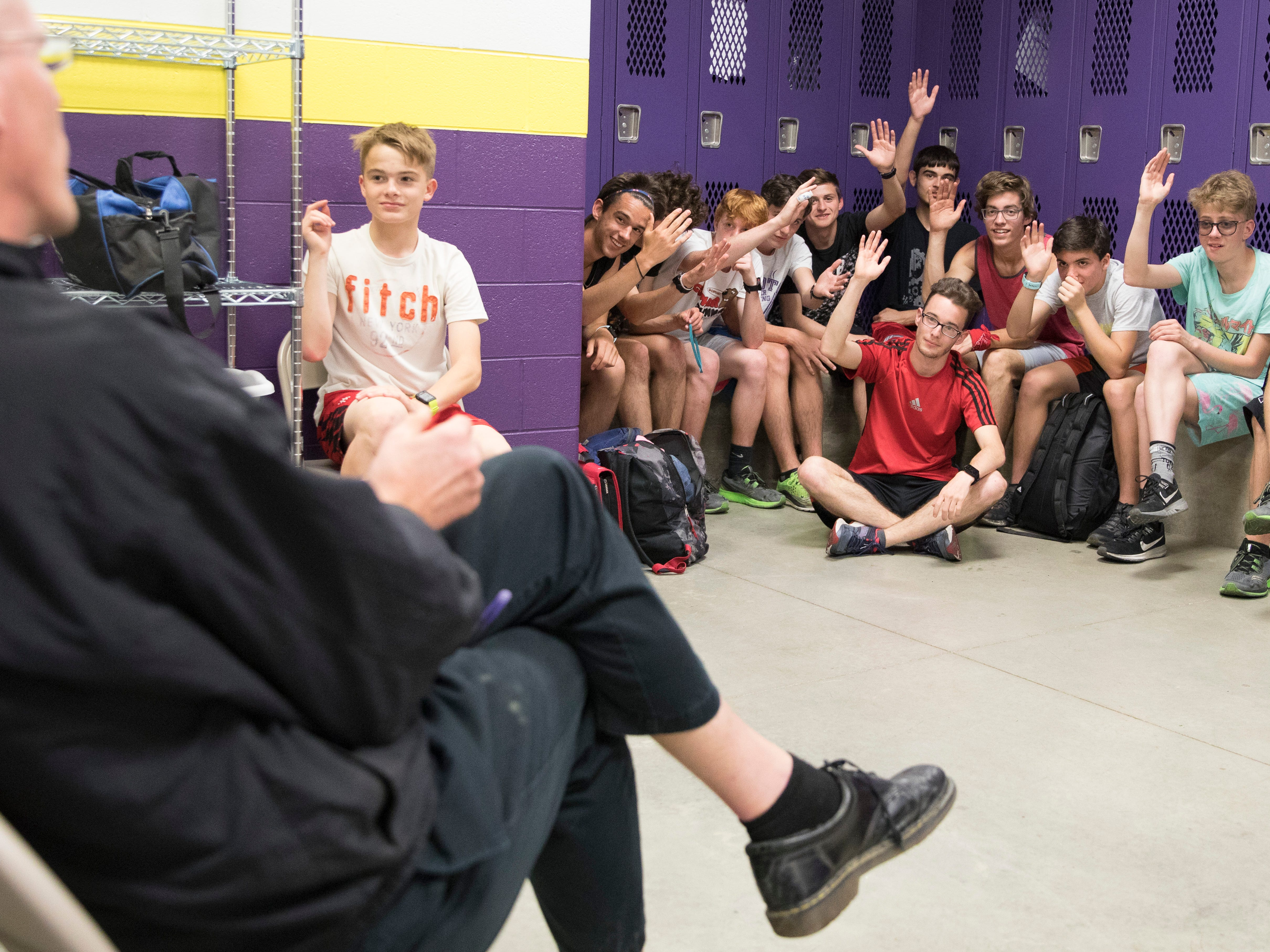 """Eric Hacker and other members of the Unioto cross country team raise their hands as Coach Paxton sees who wants to see the """"Avengers: Endgame"""" movie during the weekend. Coach Paxton tries to do as many non-running, team-building get togethers as he can."""