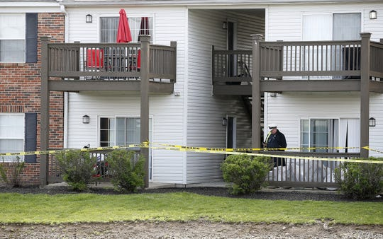 Crime scene tape surrounds an apartment building Monday, April 29, 2019, after four relatives were found dead Sunday night at Lakefront at West Chester apartment complex.