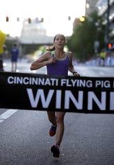 Amy Robillard, of Mason, won the women's half-marathon on Sunday, May 6, 2012.