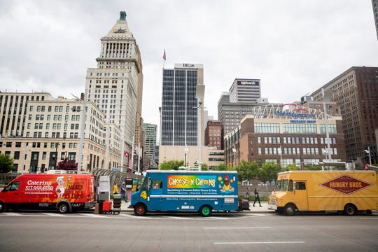 17 Taste of Cincinnati food trucks park on Second Street between Rosa Parks and Race Streets in downtown Cincinnati Monday, April 29, 2019.