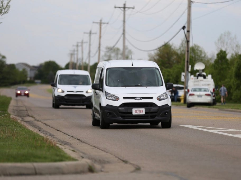 Two Butler County coroner vans leave Lakefront at West Chester on April 29, 2019, after an overnight incident left four dead.