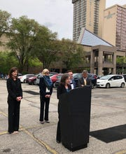 Local officials announce plans for a new hotel next to Cincinnati's convention center. From left: Amy Spiller, vice chair of the Convention and Visitors Bureau board; Port director Laura Brunner; Hamilton County Commissioner Denise Driehaus; Mayor John Cranley; and 3CDC CEO Steve Leeper