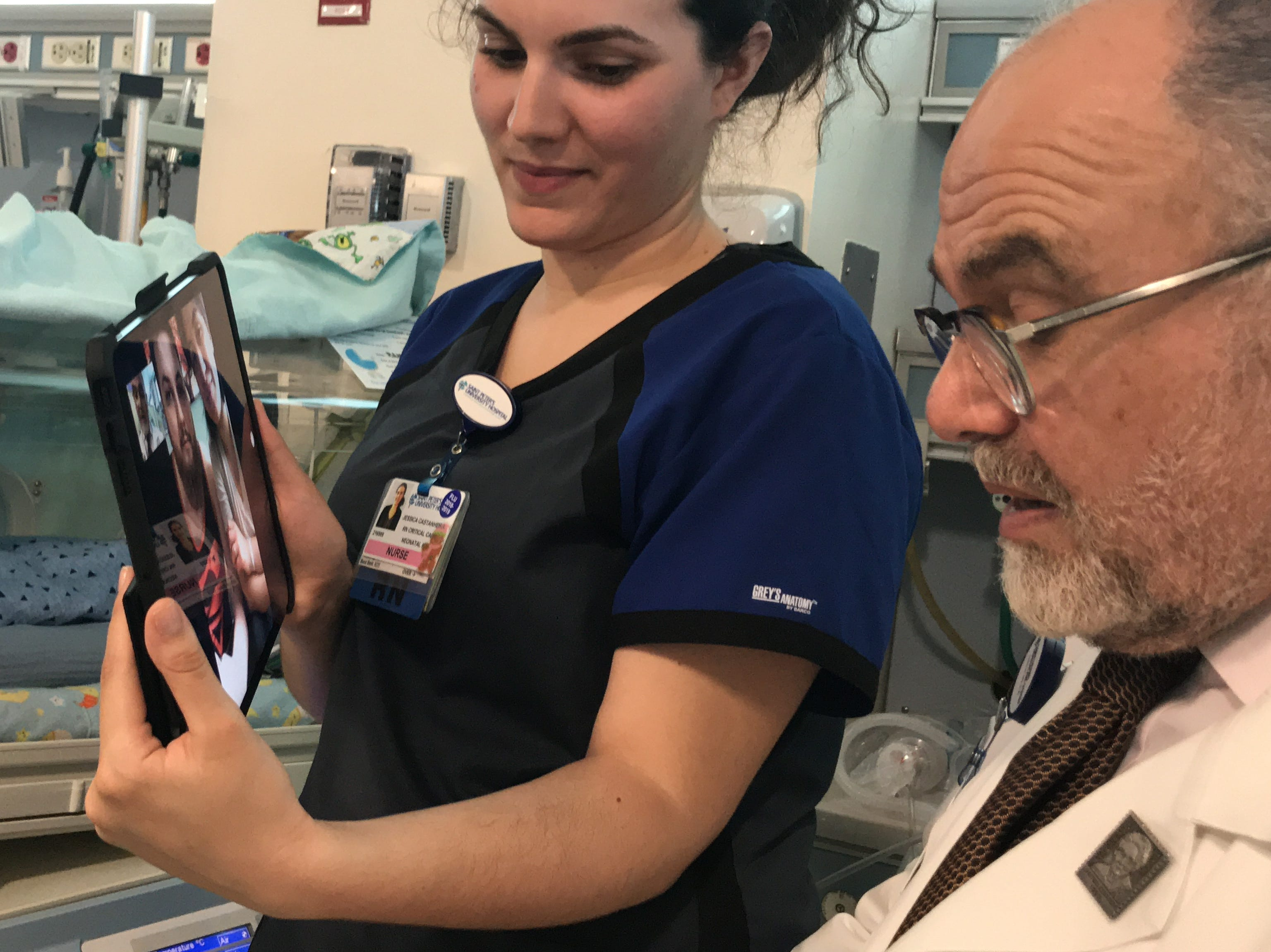 Dr. Mark Hiatt, chief of Neonatology at The Children's Hospital at Saint Peter's University Hospital in New Brunswick, and Neonatal Critical Care Nurse Jessica Castanheira, here with newborn Joseph Nardone Jr. of Rahway and his parents Sabrina Ramirez and Joseph Nardone Sr. (on the iPad), demonstrate the recently launched daily FaceTime program in the Neonatal Intensive Care Unit (NICU). The first-of-its-kind in the state, the program delivers a liveaudio and visual feed to parents whose infants need specialized long-term care.