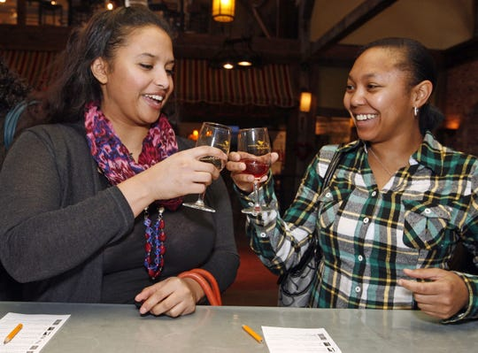 Mairobi Luzon and Gina Robinson, both of Somerset, sample wines at New Egypt's Laurita Winery, one of the participants in the Mother's Day Wine Trail Weekend.