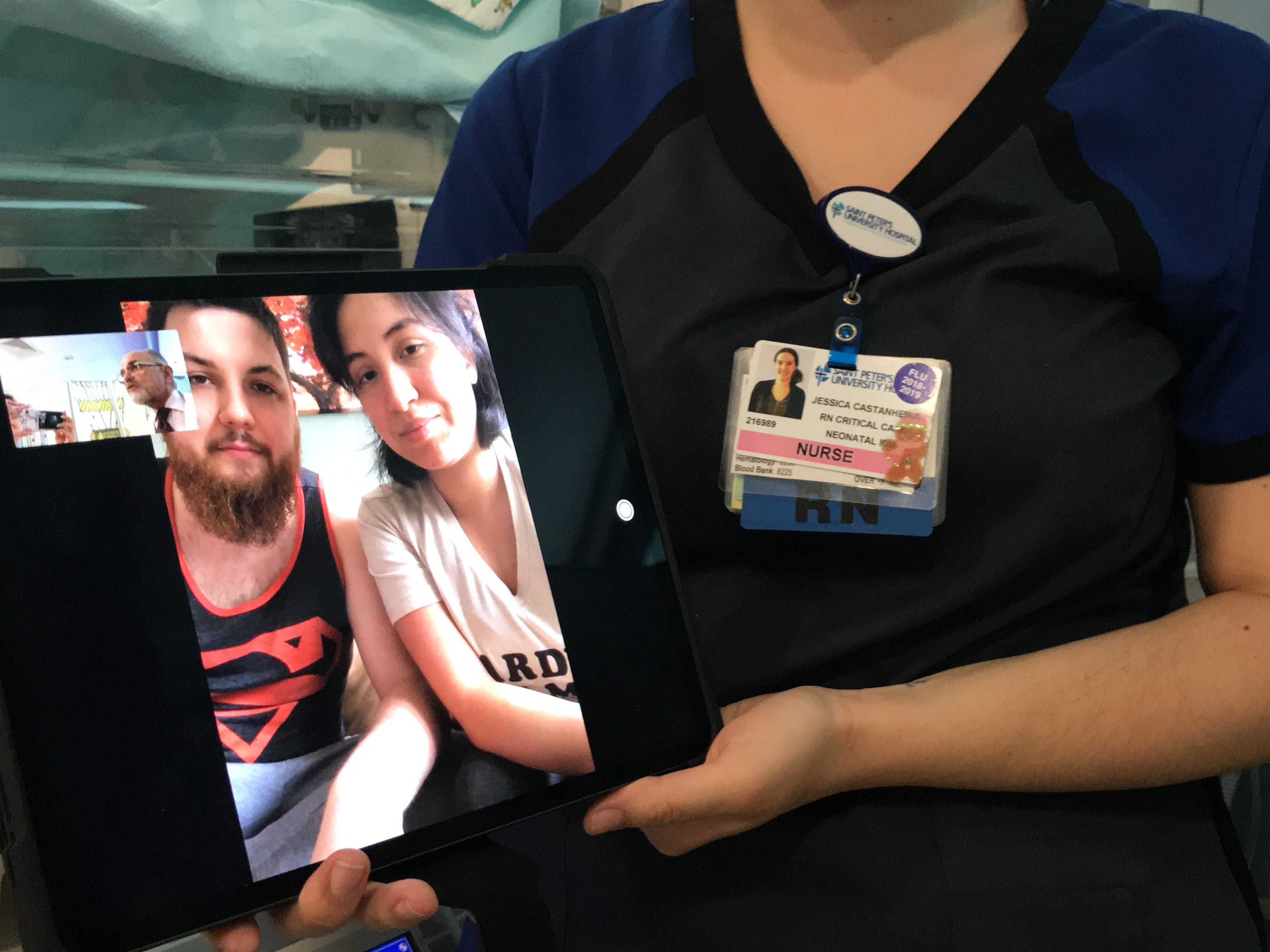 Neonatal Critical Care Nurse Jessica Castanheira, here with newborn Joseph Nardone Jr. of Rahway and his parents Sabrina Ramirez and Joseph Nardone Sr. (on the iPad), demonstrate the recently launched daily FaceTime program in the Neonatal Intensive Care Unit (NICU) of Saint Peter's University Hospital in New Brunswick. The first-of-its-kind in the state, the program delivers a liveaudio and visual feed to parents whose infants need specialized long-term care.